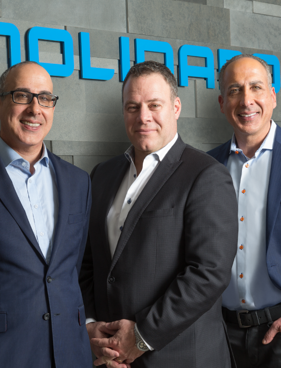 Three Molinaro Group developers smiling and posing style='width:100%'